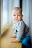 Little girl is by the window Stock Photography