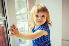 Little girl and window Stock Image
