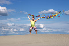 Little girl on windy beach Stock Photography