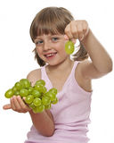 Little girl with wine grapes Royalty Free Stock Images