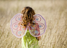 Little girl with wings stock images