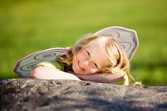 Little girl with wings Stock Image
