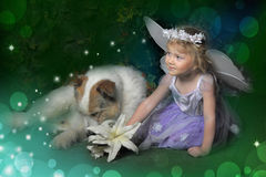 Little girl with wings and a dog Stock Photo