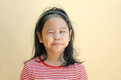 Little girl winking eye stock images