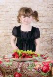 Little girl winks Stock Photo