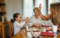 Little girl winning domino Stock Photo