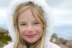 Little girl in winter. Winter portrait of a beautiful little blond girl Stock Photos