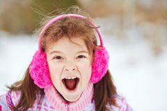 Little girl in the winter. child outdoors. Closeup portrait of a emotional little girl in the winter. child outdoors Stock Photography