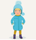 Little girl in winter clothes. Little cute girl in blue winter hat and jacket Stock Photography