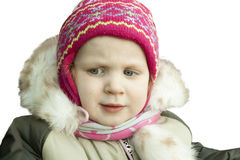 Little girl in winter clothes looking sad. On a white background Royalty Free Stock Photos