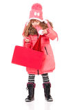 Little girl in winter clothing Stock Images