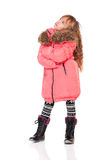 Little girl in winter clothing Stock Photo