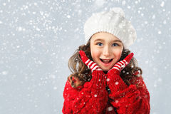 Little girl in winter clothing, think about Santa. Snow background Stock Photo