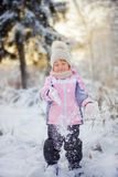 Little girl in  winter forest Stock Photography