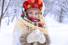 Little girl in winter forest dressed in the Ukrainian national c Royalty Free Stock Photo