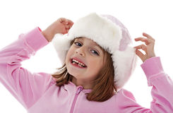 Little girl with winter fur hats Stock Image