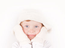 Little girl in winter hat with ear flaps. Little girl in white winter fleece hat with ear flaps & mittens portrait on white Stock Photo