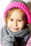 Little girl in winter hat with gloves and scarf. Stock Photography