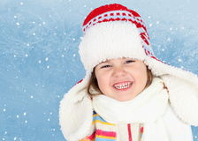 Little Girl in Winter Hat Laughing Royalty Free Stock Image
