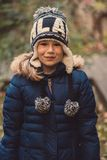 Little girl with winter hat smiling Royalty Free Stock Photos