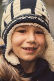 Little girl with winter hat smiling Royalty Free Stock Photography