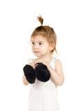 Little girl with winter headphones Stock Photos
