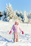 Little girl in winter mountains Stock Photo