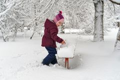 Little girl in winter outdoors. Little cute girl in winter outdoors. She rejoices in the snow and has fun stock photos