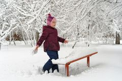Little girl in winter outdoors. Little cute girl in winter outdoors. She rejoices and fools stock images