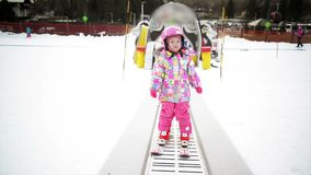 Little Girl In Winter Outfit Staying On Ski Conveyor. Kid Is Having Fun Starts Skiing. Happy Ski Experience In Resort. stock footage