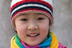 little girl in winter outfits Royalty Free Stock Photo