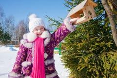 Little girl in winter park Stock Images