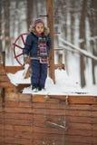 Little girl in winter park Stock Image
