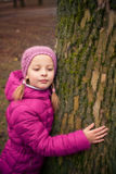 Little girl  in  winter park. Stock Photos