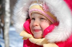 The little girl in winter park royalty free stock image
