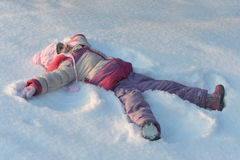 Little girl in winter park Royalty Free Stock Photo