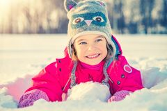 Little girl in a winter park Royalty Free Stock Images