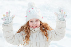 Little girl on a winter walk on clouds sky background. Royalty Free Stock Photography