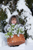 Little girl in a winter wood Royalty Free Stock Image