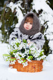 Little girl in a winter wood Stock Images