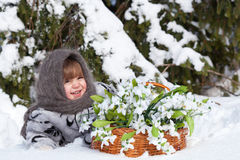 Little girl in a winter wood Royalty Free Stock Photo