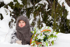 Little girl in a winter wood Stock Photo