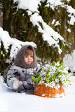 Little girl in a winter wood Stock Image