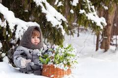 Little girl in a winter wood Stock Photos