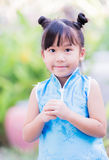 Little girl wishing you a happy Chinese New Year Royalty Free Stock Photography
