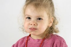 Little girl wit chubby cheeks royalty free stock image
