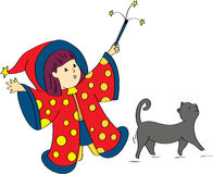 Little girl witch with cat. A little girl dress as a witch trying to spell some magic words to change the cat Royalty Free Stock Photos