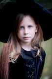 Little Girl in Witch Costume Stock Images
