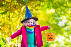 Little girl in witch costume at Halloween Royalty Free Stock Photos