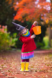 Little girl in witch costume at Halloween Stock Photography